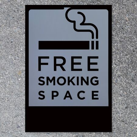 space   area: Signboard of smoking space area on concrete wall background Stock Photo