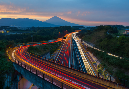 Japan highway long exposure and Mountain Fuji in autumn season evening Фото со стока