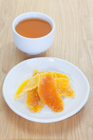 dehydrate: Piece of Dehydrated mango and chinese hot tea Stock Photo