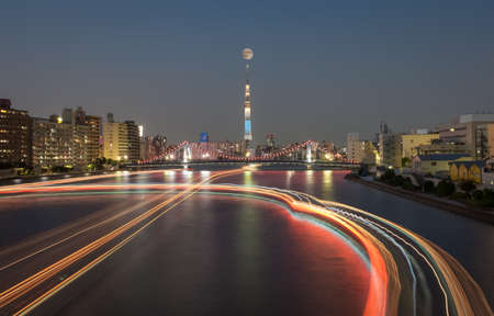 moon  metropolis: Tokyo river view with Tokyo Skytree in full moon Editorial