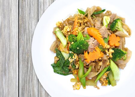 chinese food: Chinese fried noodle with pork , egg and green vegetable