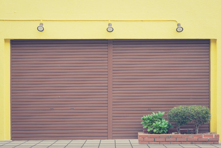 siderurgia: Brown metal shutter door of store closed