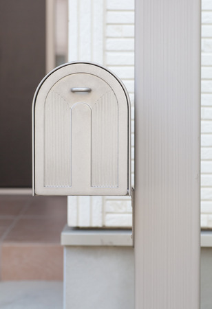 metal post: White metal post box in front house Stock Photo