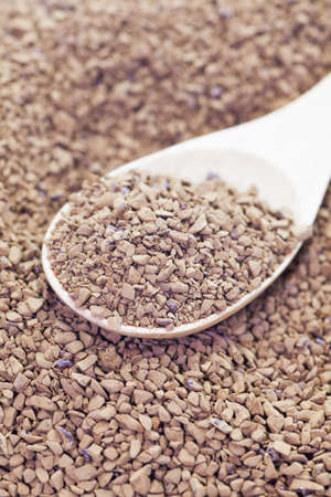 instant coffee: Granules of instant coffee in wooden spoon