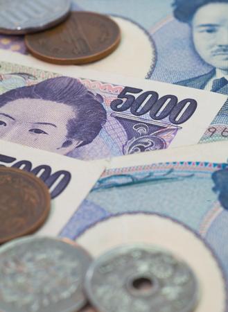 japanese yen: Close - up Japanese yen banknotes and Japanese yen coin Stock Photo