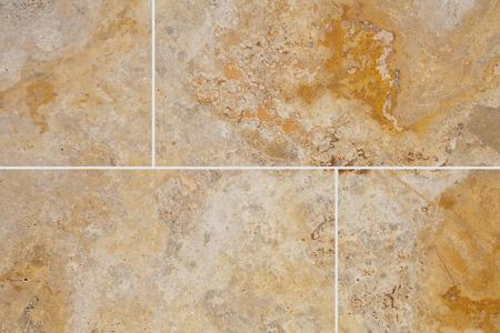 piso piedra: Brown stone floor tile seamless background and texture Foto de archivo