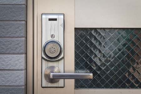 door handle: Modern door handle with security system lock on metal door