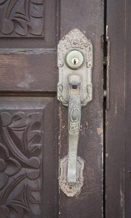 door handle: Antique door handle and old wooden door
