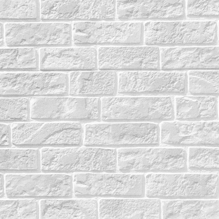 White brick stone wall seamless background and texture