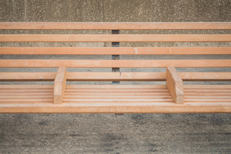 wood bench: Outdoor brown wood bench at public park area