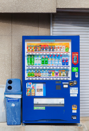 non alcoholic: TOKYO, JAPAN - DEC 27, 2015 : Vending machines of various company in Tokyo. Japan has the highest number of vending machine per capita in the world at about one to twenty three people.