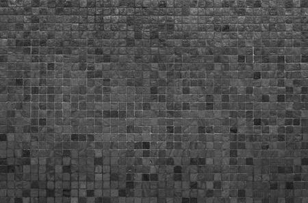 Grijze en zwarte mozaïek muur textuur en achtergrond Stockfoto
