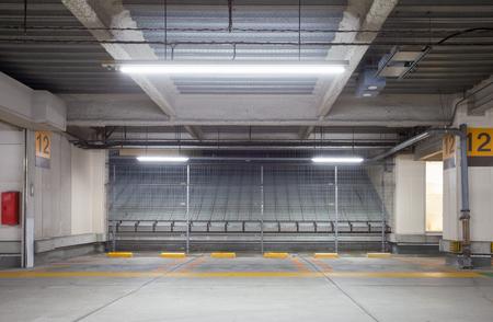 parking lot interior: Parking garage underground interior, neon lights at night