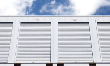 rental: Exterior of white storage unit or small warehouse for rental