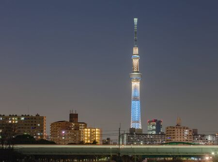 Tokyo skytree and city building at night 新闻类图片