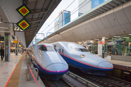 high speed train: TOKYO, JAPAN - JAN 22: Shinkansen in Tokyo, Japan on JAN 22, 2016. Japans main islands, are served by a network of high speed train lines that connect Tokyo with most of the major cities. Editorial