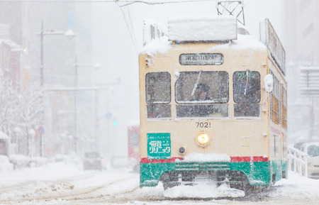 transportation company: Toyama , Japan - Jan 24 : Toyama Railway and Toyama city in snow day on JAN 24 ,2016 in Toyama , Japan. Toyama Regional Railway is a transportation company in Toyama, Toyama, Japan. The company is commonly known as Chitetsu Editorial