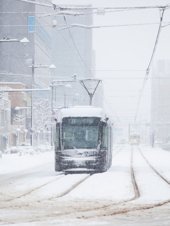 transportation company: Toyama Railway and Toyama city in snow day on JAN 24 ,2016 in Toyama , Japan. Toyama Regional Railway is a transportation company in Toyama, Toyama, Japan. The company is commonly known as Chitetsu Stock Photo
