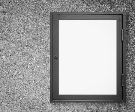 sidewalk sale: Wood window display frame on vintage cement wall background Stock Photo