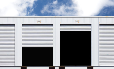 self storage: Exterior of white storage unit or small warehouse for rental