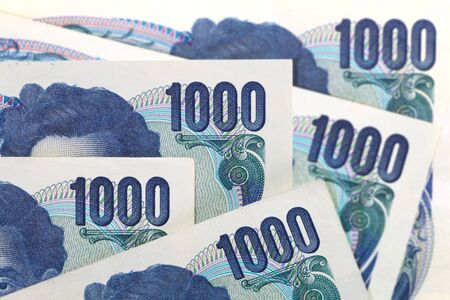 japanese currency: Close - up of japanese currency yen bank notes Stock Photo