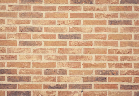 Brown stone brick wall texture and background seamless