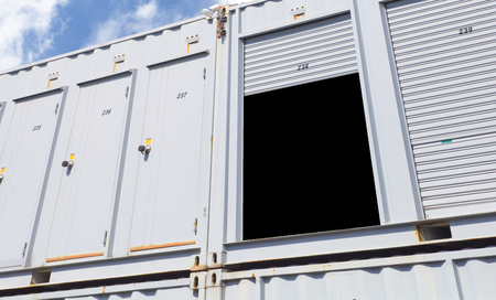 storage unit: Exterior of white storage unit or small warehouse for rental