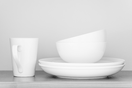 kitchen equipment: White coffee cup and white bowl in kitchen cabinet