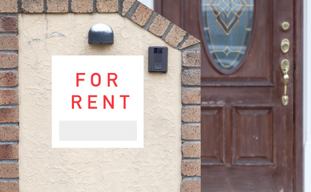 front house: Rent Real Estate Sign in Front of house