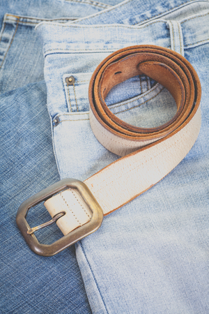 leather belt: Close - up Leather belt and blue denim jean Stock Photo