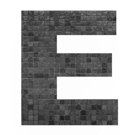 old english letters: English alphabet letter E with black mosaic background photo isolated on white background