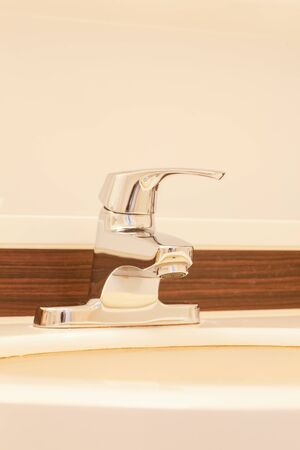 water tap: Water tap and ceramic sink at bathroom