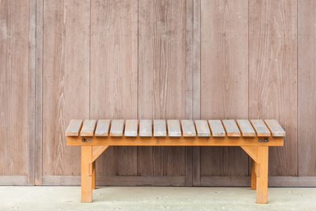 wood bench: Wood bench in front of wooden house