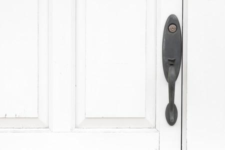 door handle: Antique door handle and white wood door