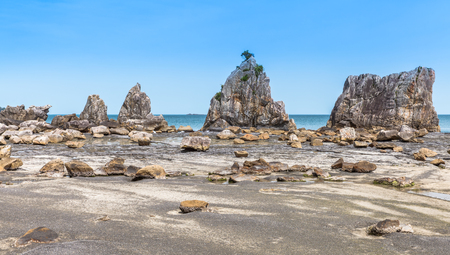 unusually: Hashigui-iwa Rock , a straight line of large and small unusually shaped rocks which stretches for around 850 meters at Kushimoto Town , Wakayama prefecture , Japan