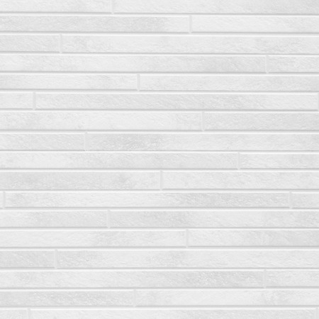 The modern white concrete tile wall background and texture . Banco de Imagens