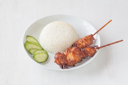 chicken satay: Chicken satay – grilled chicken skewers and white rice