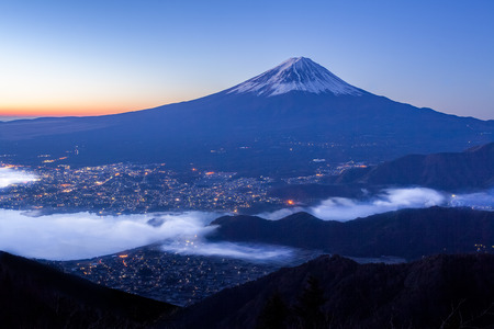 panoramic sky: Mt.Fuji and Kawaguchiko lake with sea of mist in autumn season