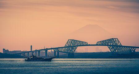 Tokyo bay at sunset with Tokyo gate bridge and Mountain Fuji