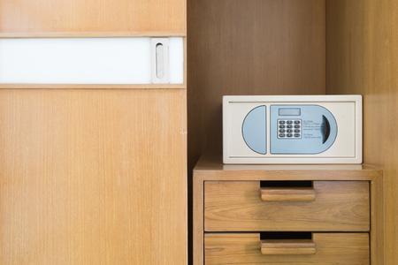 safe box: Safe box and wood wardrobe  in hotel Stock Photo