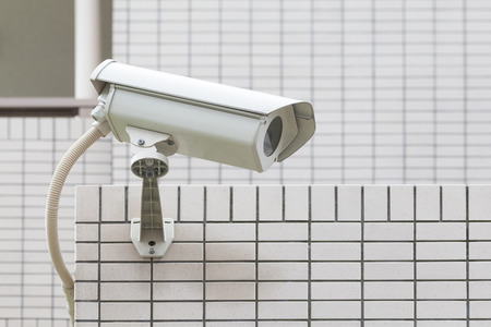guard house: Video camera security system on the wall of the building