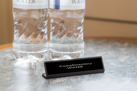 complimentary: Complimentary water bottle for hotel guest in hotel room Stock Photo