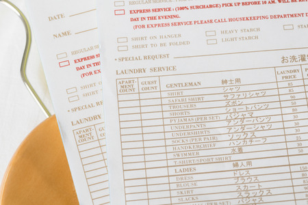 laundry room: Laundry room service form at hotel room Stock Photo