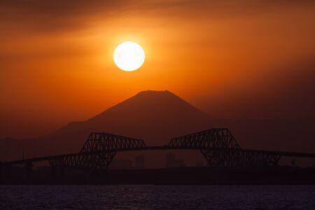 mountaintop: Diamond Fuji , View of the setting sun meeting the summit of Mt. Fuji