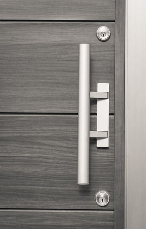 door handle: Silver metal door handle and wood door