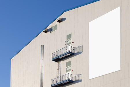 warehouse building: Blank large billboard at Industrial warehouse building