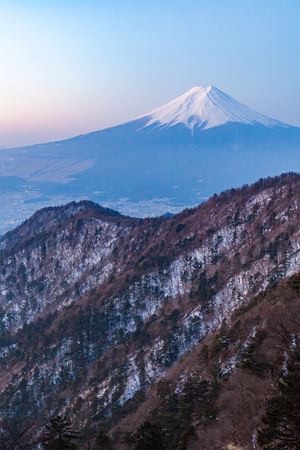 Mount Fuji during sunrise time in winter season seen from Top of Mt. Mitsutoge Stock Photo