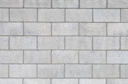 Concrete block wall seamless background and texture
