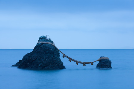 Meoto Iwa (the Wedded Rocks) are two sacred rocks in the ocean near Futami, a small town in Ise City Stock Photo