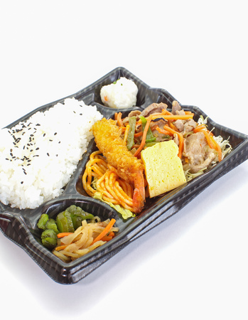 Bento , a single-portion takeout or home-packed meal common in Japanese cuisine. Stock Photo